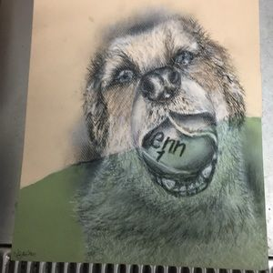 Charcoal drawing of a dog holding a tennis ball